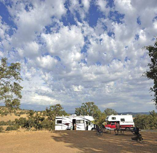 Off the Grid RV'ing. Image of 2 RV's camping out in a field. Image is in full colour.
