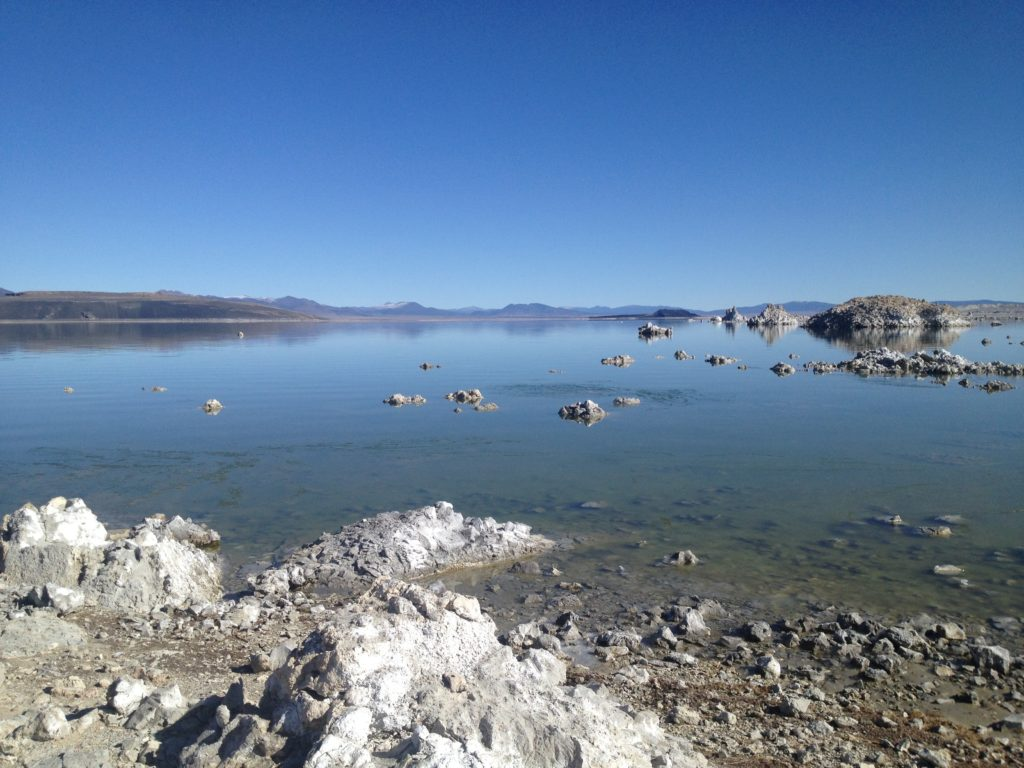 Mono Lake showing the water with mountains in the far background.