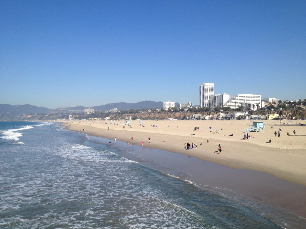 Santa Monica beach. Ocean on the left with the beach on the right. Image is in full colour.