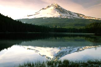 Oregon, Mount Hood. Picture taken from far away showing the mountain and its reflection on a lake.