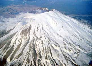 Mt. St. Helens distant shot of a single mountain covered in snow. Image is in full colour